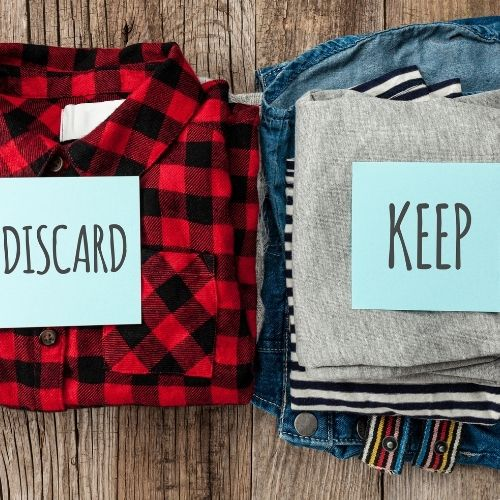 clearing the clutter by sorting clothes to keep or donate