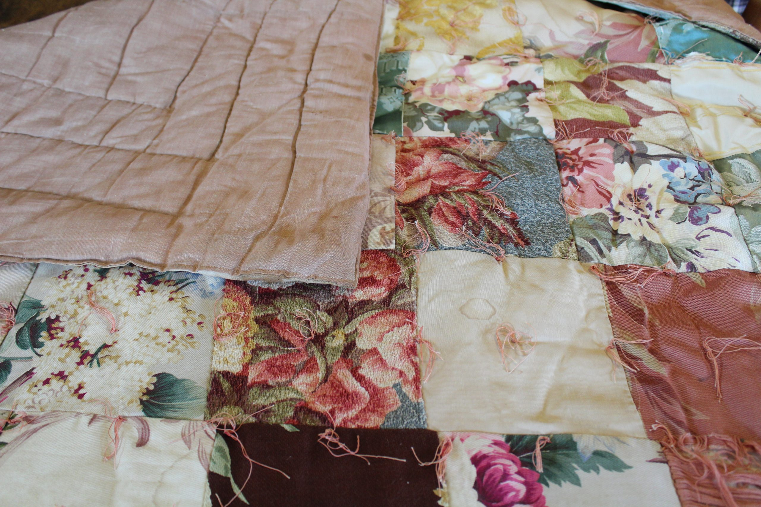 quilt with rose-patterned squares