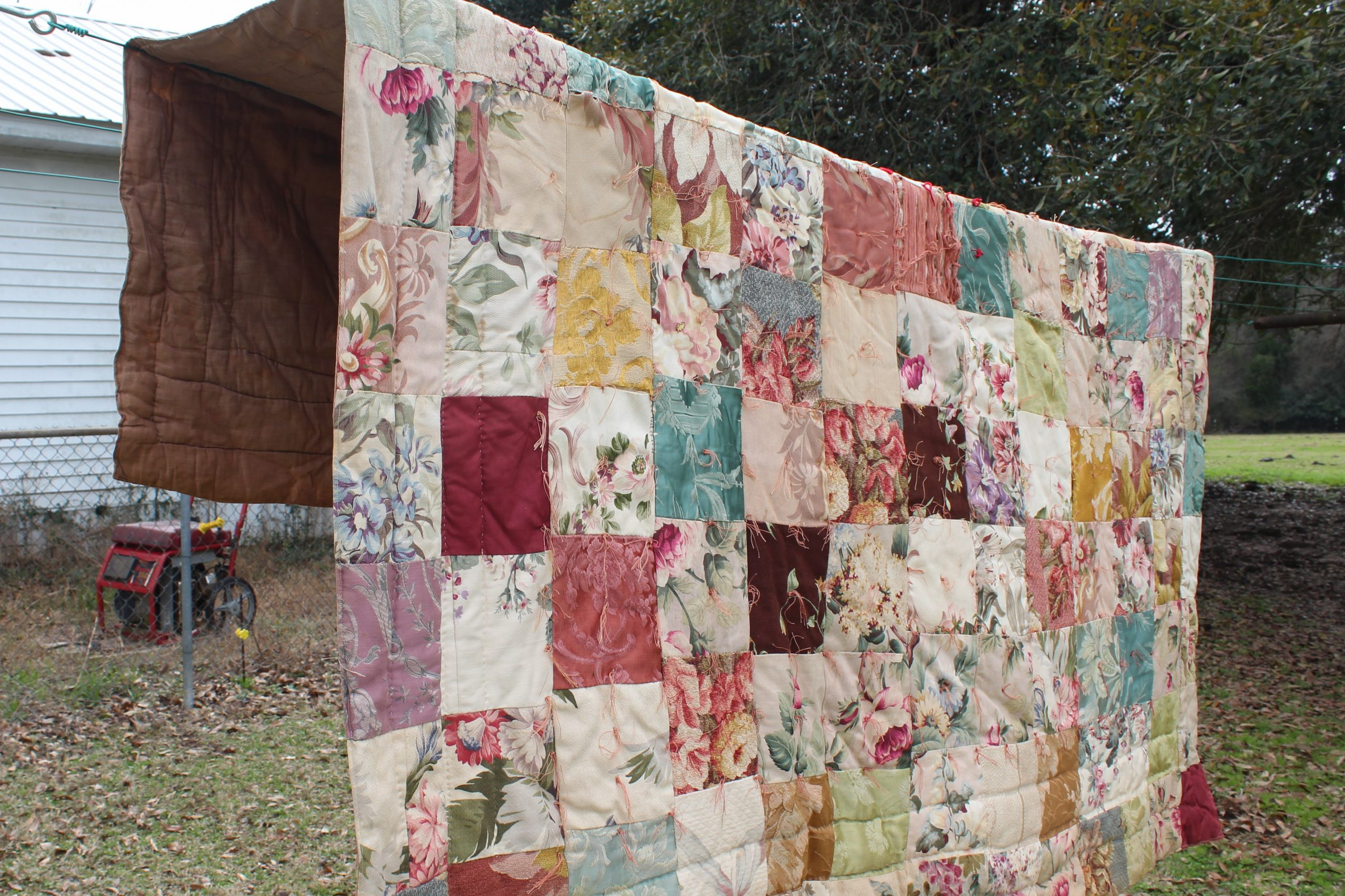 Quilt hanging on clothesline