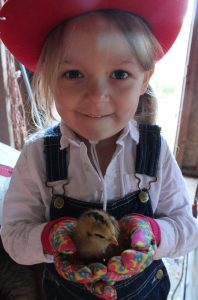 young girl holding a chick