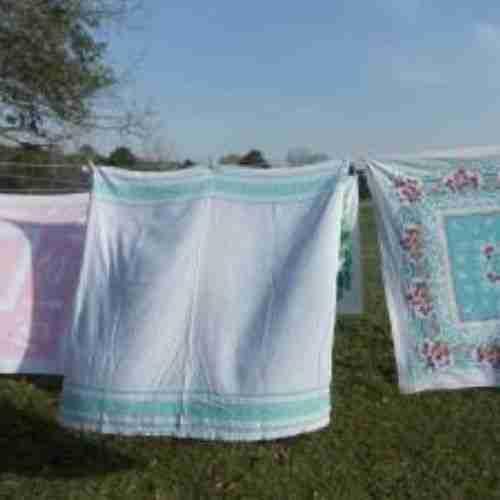vintage table cloths on a clothesline