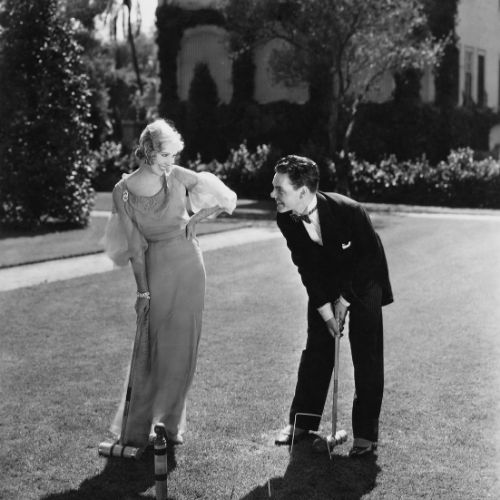 vintage image of a man and woman playing lawn games