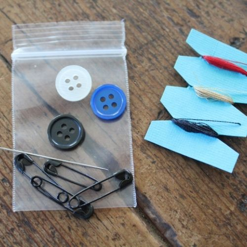 filling the container for a matchbook size sewing kit