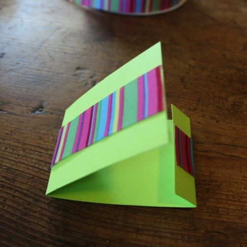 folding the outside of a matchbook sewing kit