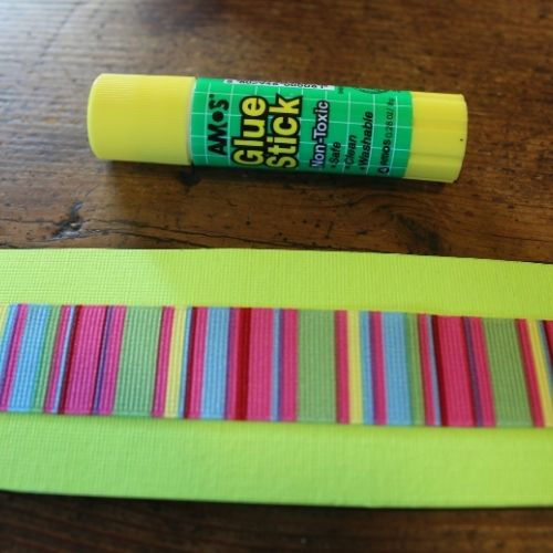 "ribbon glued onto a 6""x9"" piece of cardstock for a matchbook sewing kit"
