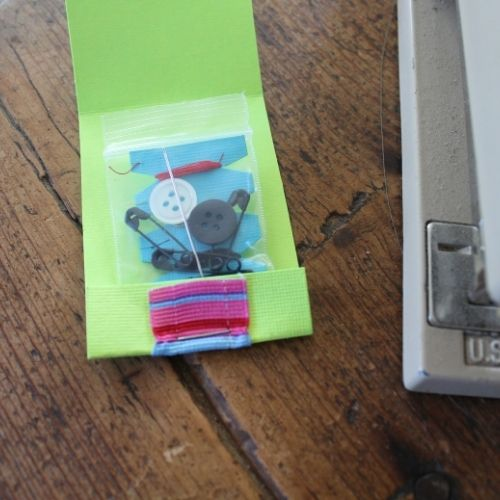 staple the bag to the outside of a matchbook sewing kit