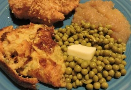 corn casserole served with fried chicken and english peas