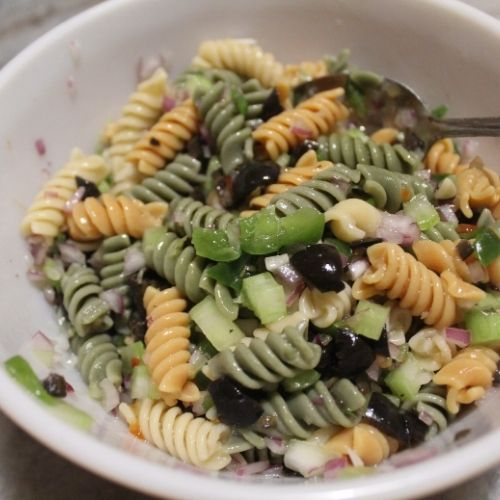 a bowl of colorful pasta salad