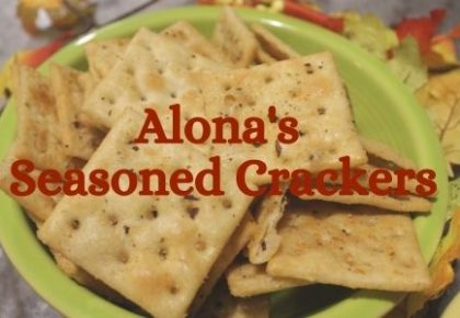 a green bowl filled with Alona's seasoned crackers
