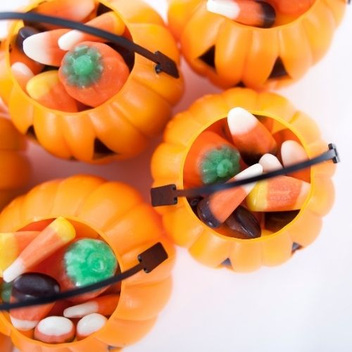 plastic pumpkins filled with candy as prizes for a Halloween party