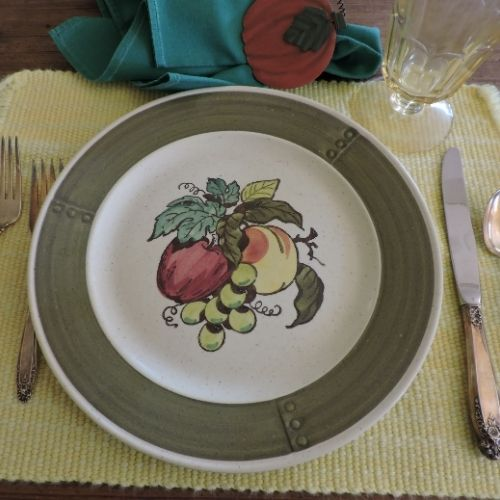 Celebrating Thanksgiving by setting the table with the seasonal dishes and flatward