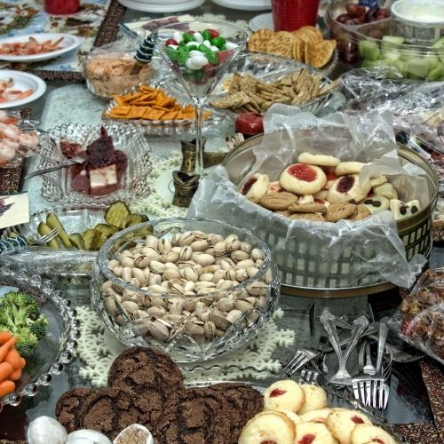 a table full of christmas snacks, cookies, nuts
