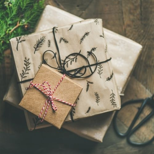 gifts wrapped in cream paper with green ribbon