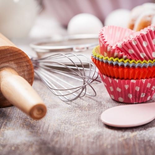 rolling pin, cupcake papers, and kitchen items