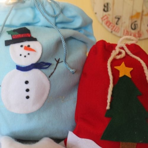 drawstring bag with a snowman and Christmas tree design