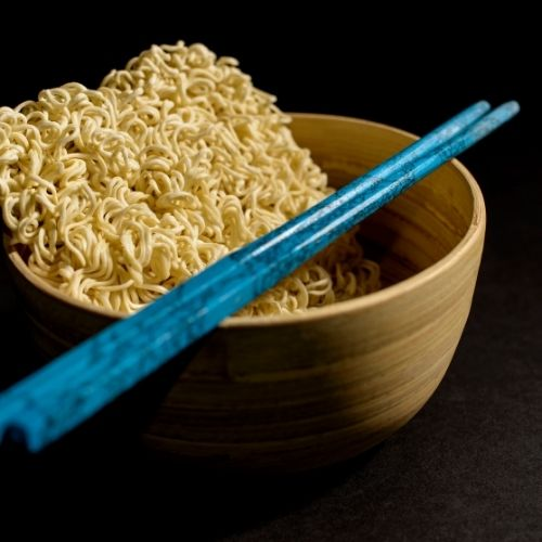 a bowl of ramen noodles and chopsticks