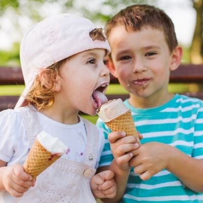 two children eating ice cream cones