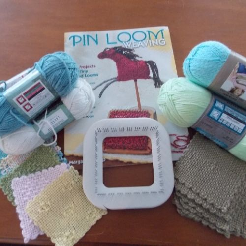 a pin loom, book and yarn to create a kit for a weaver