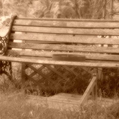 a sepia print of a park bench