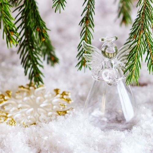 a glass Christmas angel set in snow