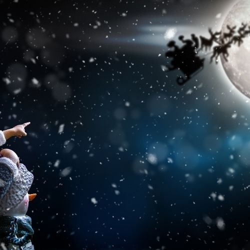 holiday quotes on santa's sleigh highlighted against the moon