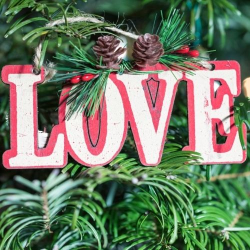 a wooden ornament that spells LOVE