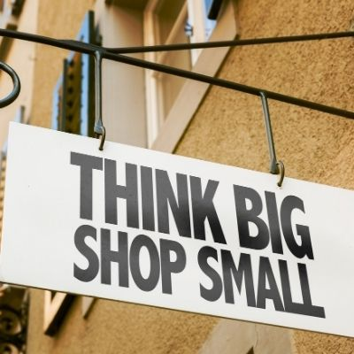 a sign that says think big shop small