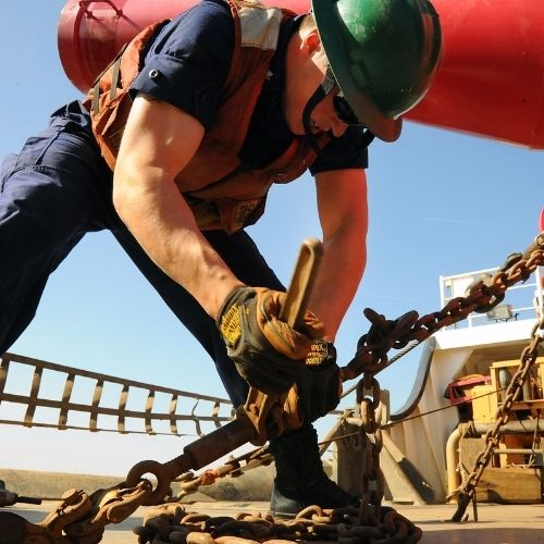 a soldier working on a ship chain