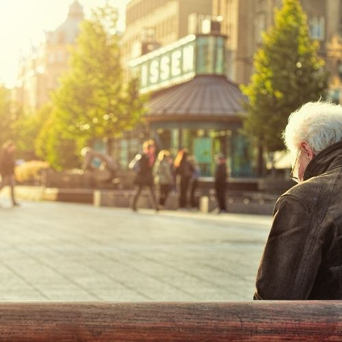 a lonely veteran on a park bench