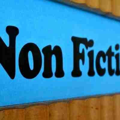non fiction plaque on a shelf