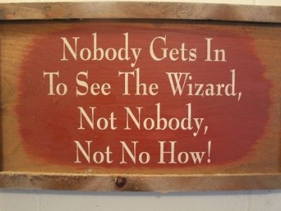 a sign that says 'nobody gets in to see the wizard not nobody not no how!'